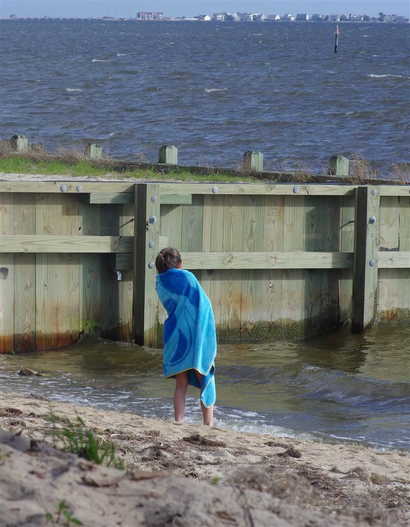 Child Wrapped in Towel Looking Out at the Water
