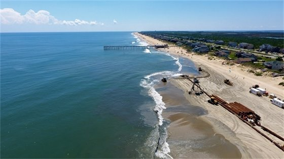 Beach nourishment construction taking place near Mile Post 18 on August 8, 2019.