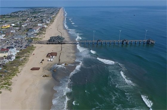 Beach nourishment construction taking place just south of Jennette's Pier in Nags Head on Monday, July 29, 2019.