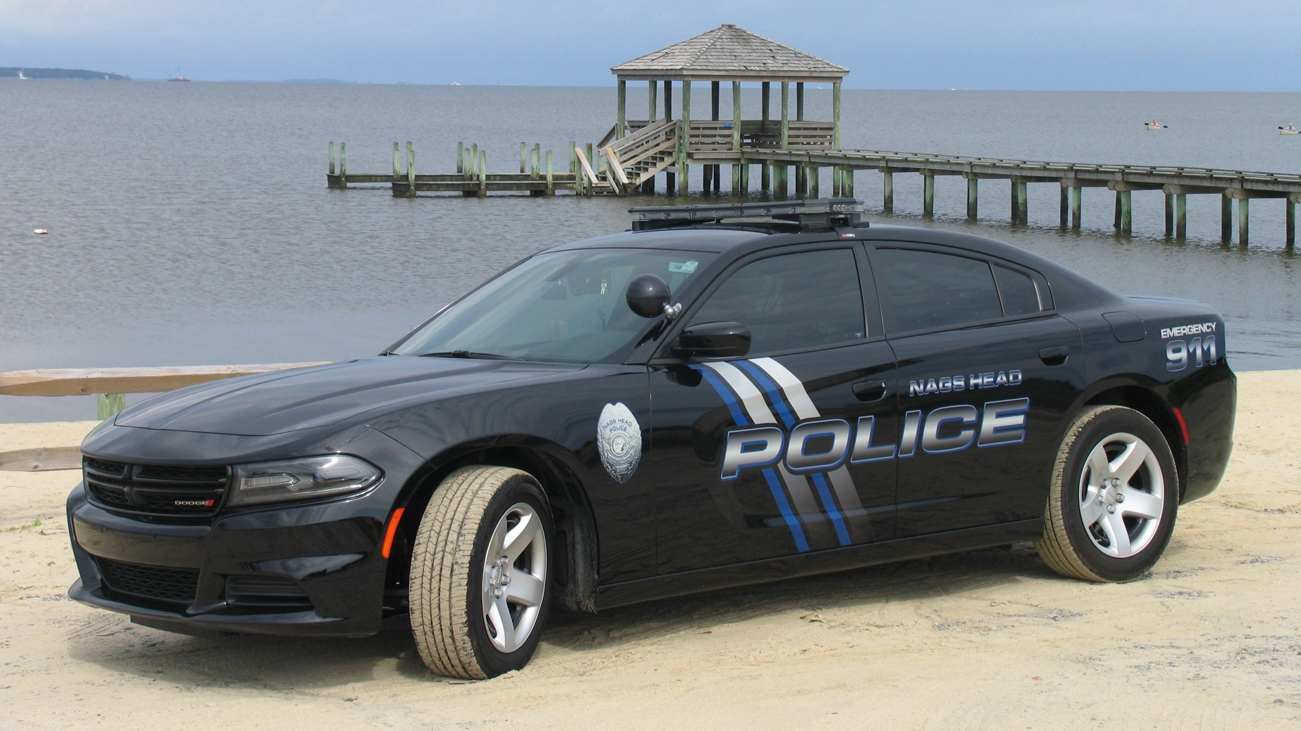 Close up of police car on the beach